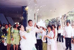 We are showered with confetti while holding the doves